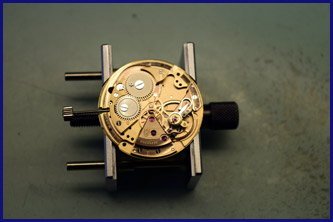 Workings of watch being repaired